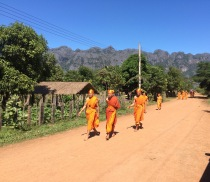 Monks can be found wandering around many little towns in Laos.